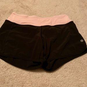 Lululemon light pink and black shorts